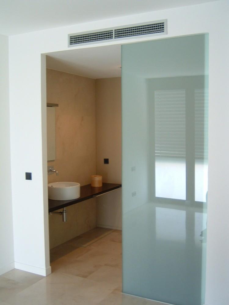 Baño Dormitorio Integrado:Vivienda entre medianerasDS26 :: NUÑO ARQUITECTOS Arquitectura